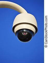 Hi-tech dome type camera over a blue sky