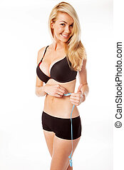 blonde woman measuring her stomache - happy blonde woman...