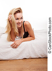 woman wearing black lingerie - happy blonde woman on bed...