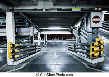 Parking garage in basement, underground interior, stop sign entrance