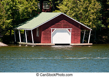 Red boathouse with covered dock