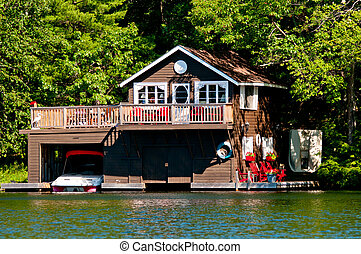 Wooden cottage and boathouse