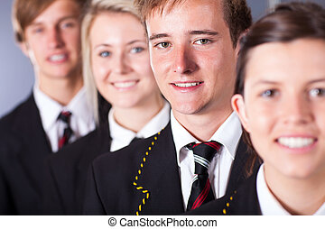 group of high school students in uniforms closeup portrait