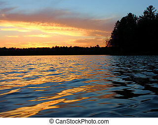 Northern Wisconsin Lake Sunset - Sunlight reflects off...