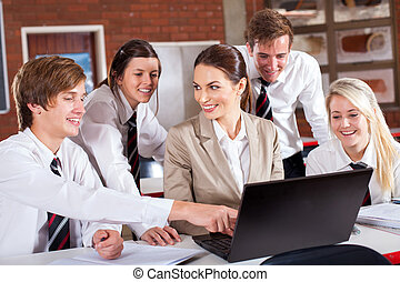 teacher and students with laptop