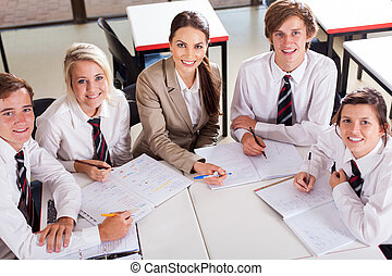 high school teacher and students - overhead view of high...