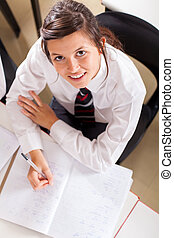high school girl studying - overhead view of a high school...