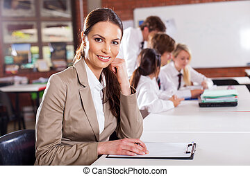 female school teacher in classroom