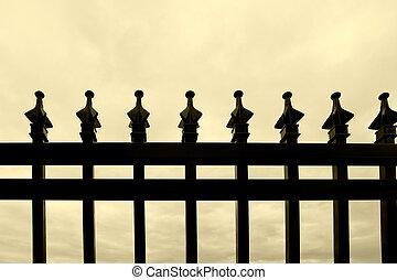 Black wrought-iron fence