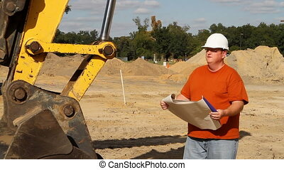 Foreman With Prints - Construction foreman at an excavation...