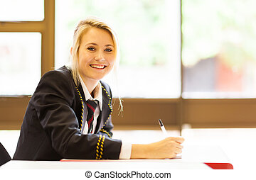 happy high school girl studying in classroom