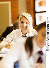 pretty high school girl in classroom