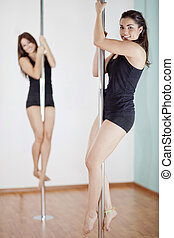 Girls love pole fitness class - Cute young women in the...