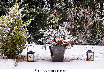 Lanterns on the terrace in the snow