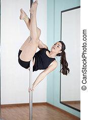 Beautiful young woman pole dancing - Sexy young woman...