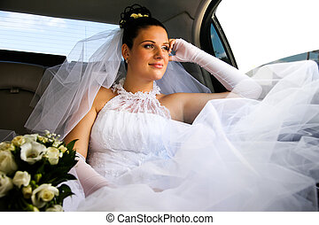 Bride in car - Portrait of young girl wearing white wedding...