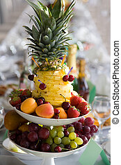 Fruit dessert - Mixture of different fruits and berries on...