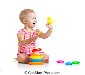 baby girl playing with big toy isolated on white background
