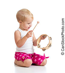 Baby playing with musical toy. Isolated on white background...