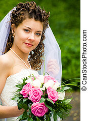 Young bride - Portrait of beautiful bride with rose bouquet...