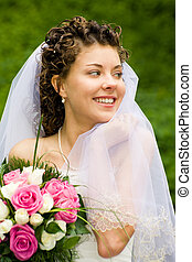 Woman - Portrait of beautiful bride with smile holding the...