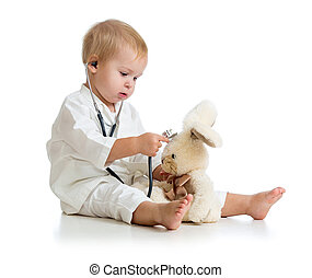 Adorable child with clothes of doctor and teddy bear over white