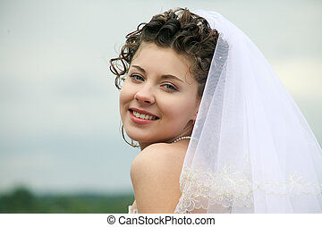 Joyful bride - Portrait of happy bride looking at camera...