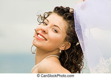 Happy bride - Image of happy young bride touching wedding...