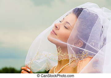 Pleasure - Photo of half-face of gorgeous happy bride...