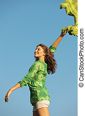 Freedom woman - Happy woman with a colored tissue against...