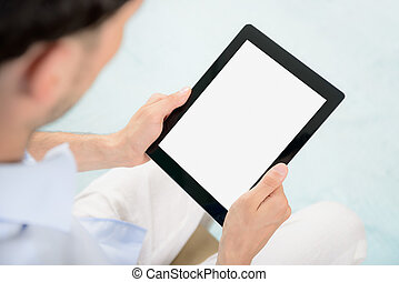 Blank tablet computer in hands