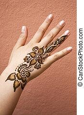 Henna Tattoo - Henna tattoo on the back of a hand