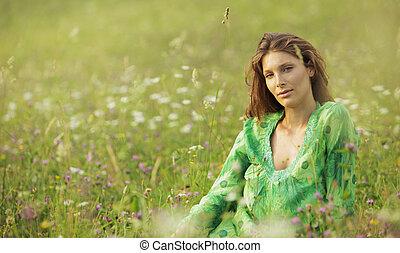 Woman in a flowers field