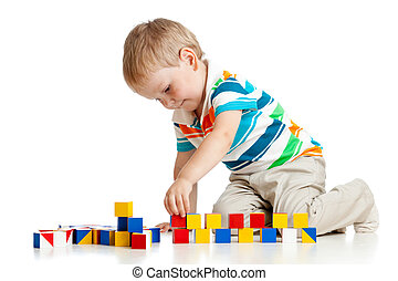 kid boy playing toy blocks isolated on white background