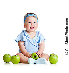 Funny baby girl with green apples isolated on white background