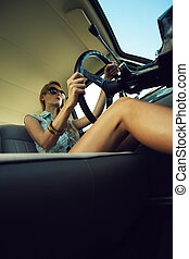 Young woman in an old fashioned car - Beautiful young woman...
