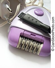 Epilator, adapter and a little brush