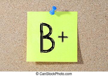 B+ grade written on a test paper.