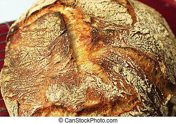 Closeup of Artisan Bread - A closeup of a artisan loaf of...