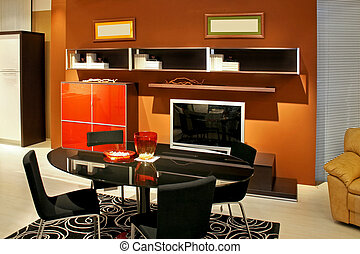 Brown dinning room with big glass table