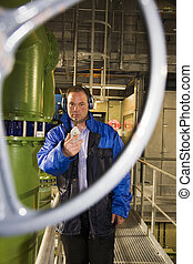 Engineer running tests - Engineer measuring noise levels in...