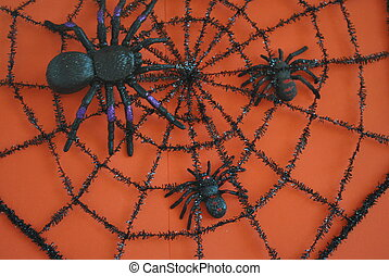 spider web on orange background - a large and 2 small...
