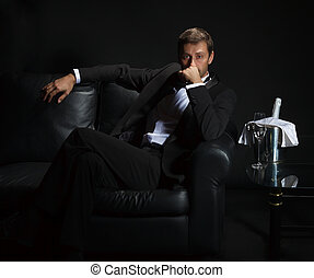 Sexy man in tuxedo waiting for his date - Sexy handsome man...