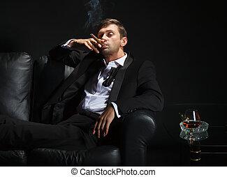 Macho man in a nightclub - Macho man in a stylish tuxedo...