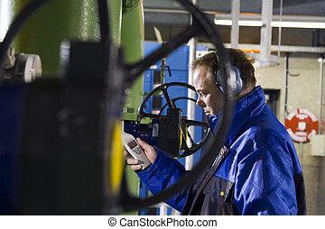 Engineer running tests - Engineer measuring noise levels in...