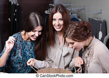 Showing the purchases to her friends