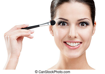 Woman putting on makeup with cosmetic brush - Woman applying...