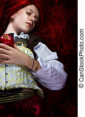 Young woman with red apple in a poetic representation