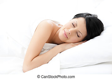 Woman sleeps in bed, white background