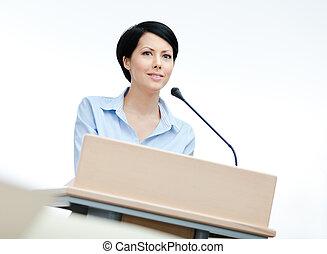 Female orator at the podium - Female speaker at the podium....